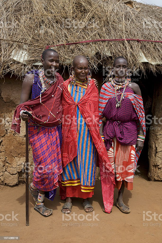 Young Masai man and woman with old wrinkled senior. Kenya. royalty-free stock photo