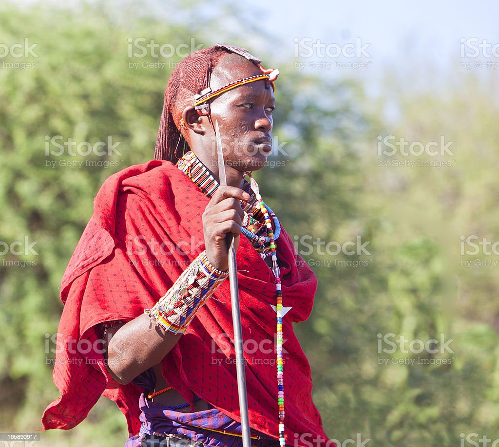 Young masai morani (warrior) with traditional jewellry and long hair. stock photo