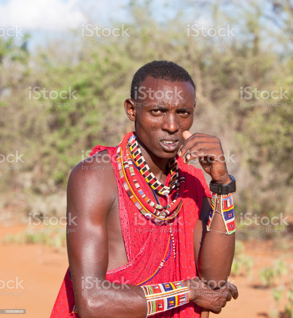 Young masai morani (warrior) with traditional jewellry.. stock photo
