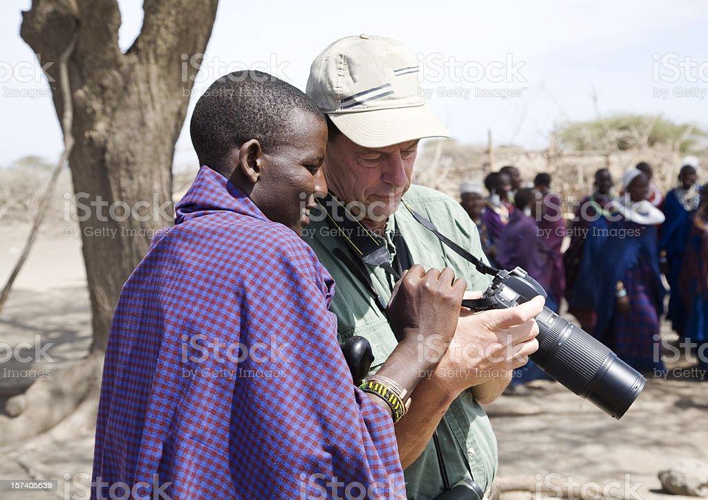 Young Masai warrior lokking at ta tourist's camera. royalty-free stock photo