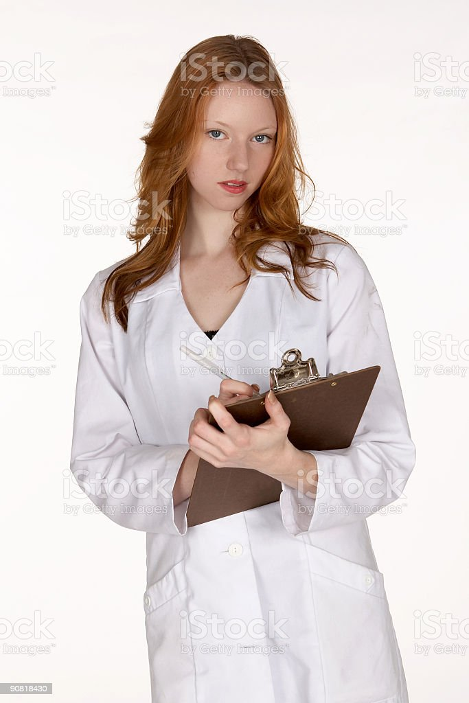 Young Medical Professional with Pen and Clipboard stock photo