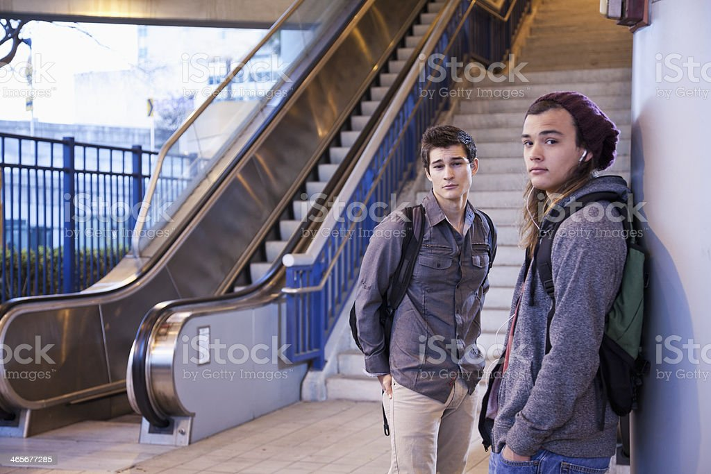 Young men at bottom of stairs stock photo