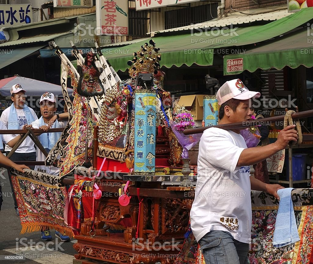Young Men Carry a Sedan Chair stock photo