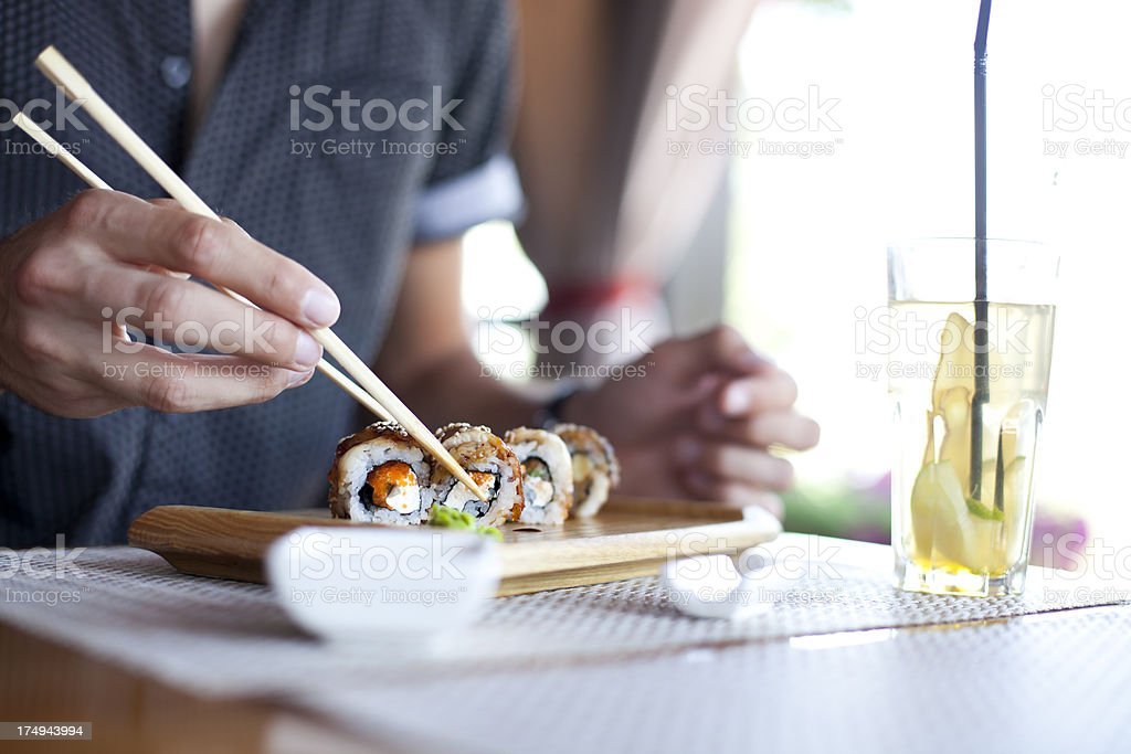 Young Men Eating Sushi stock photo