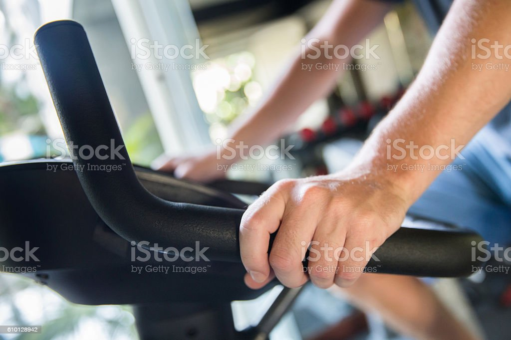 Young men exercise at the gym stock photo