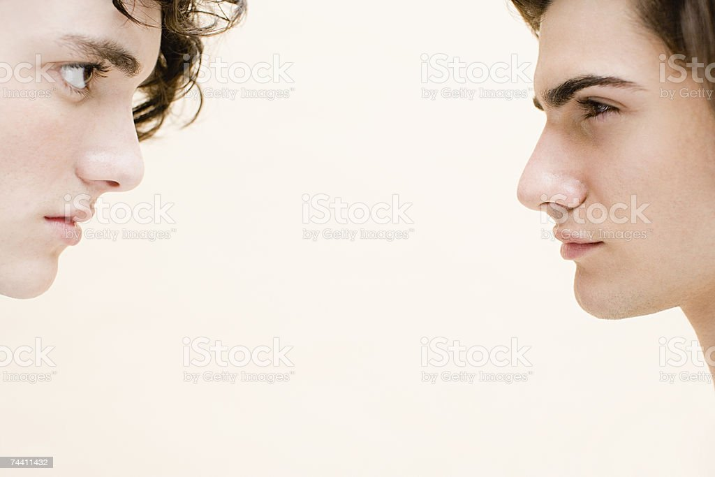 Young men face to face stock photo