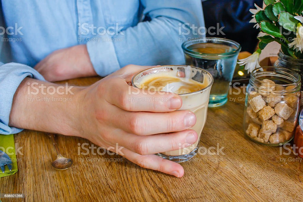 Young men holding coffee cup stock photo