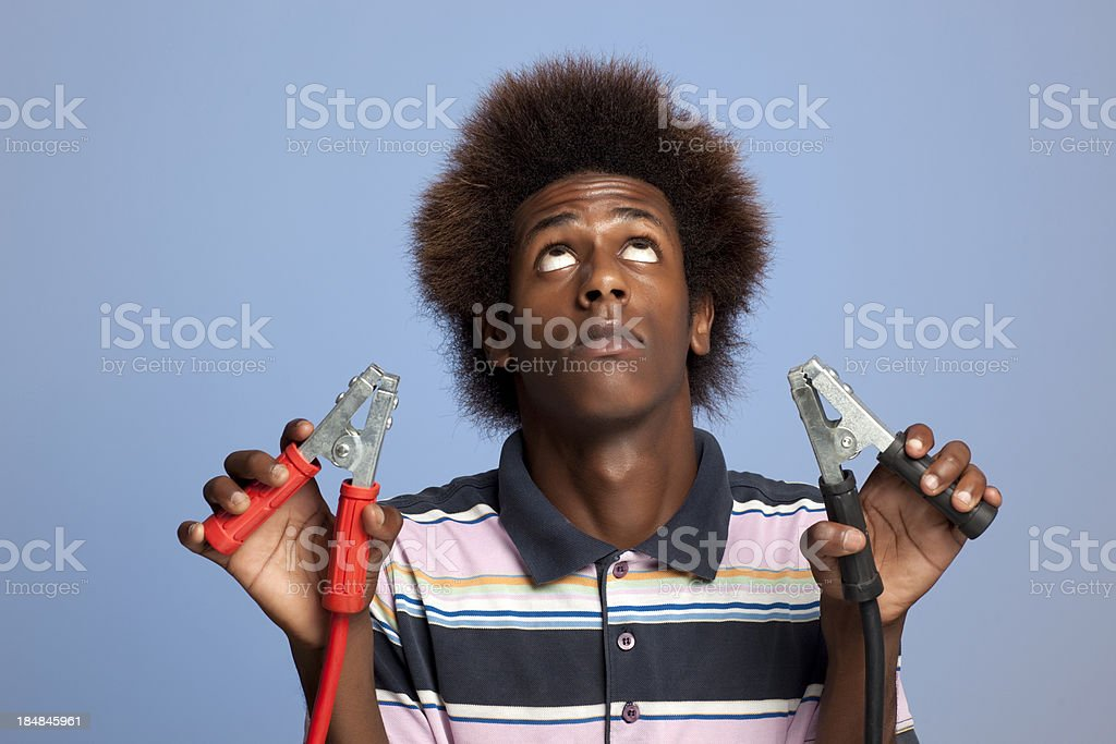 Young men holding jumper cables. royalty-free stock photo