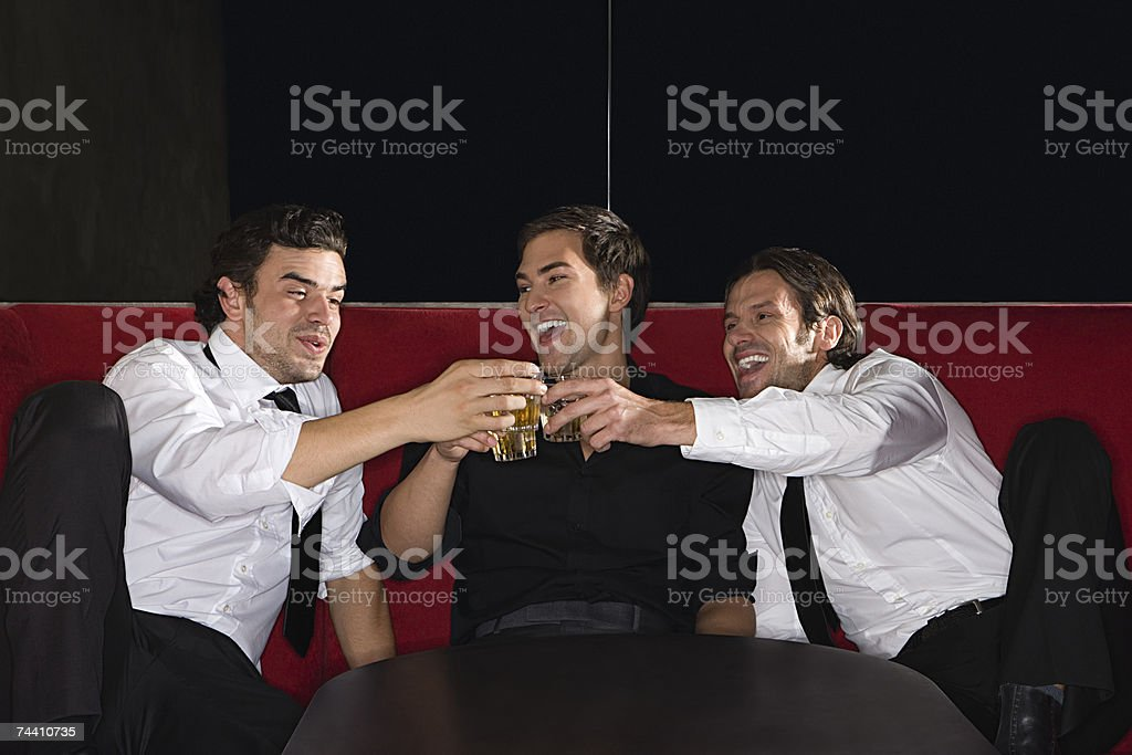 Young men in a bar stock photo