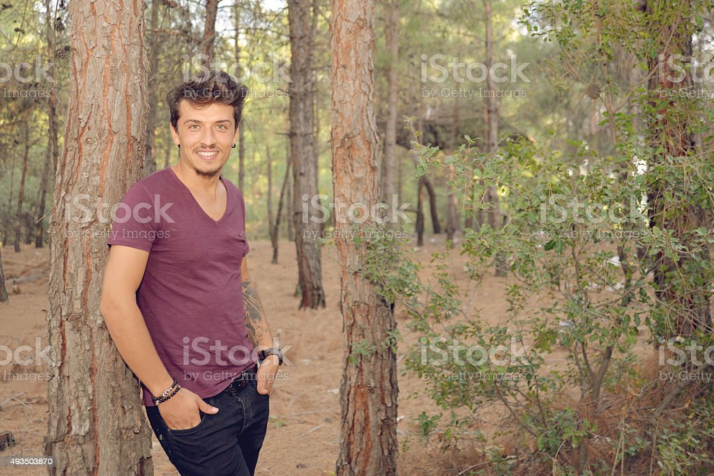 young men in forest stock photo