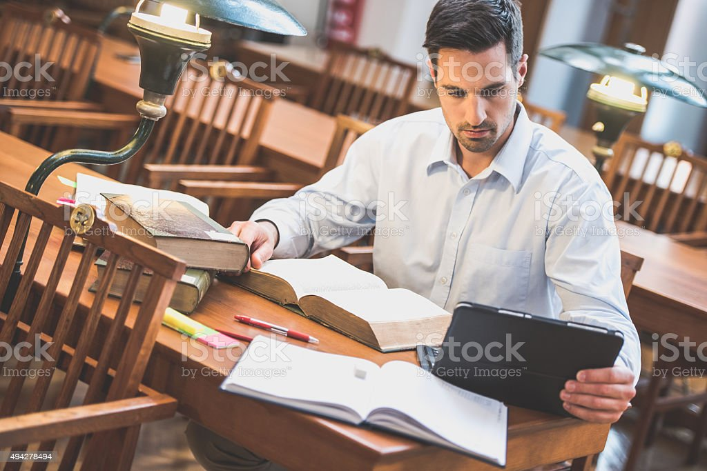 Young men in Library stock photo