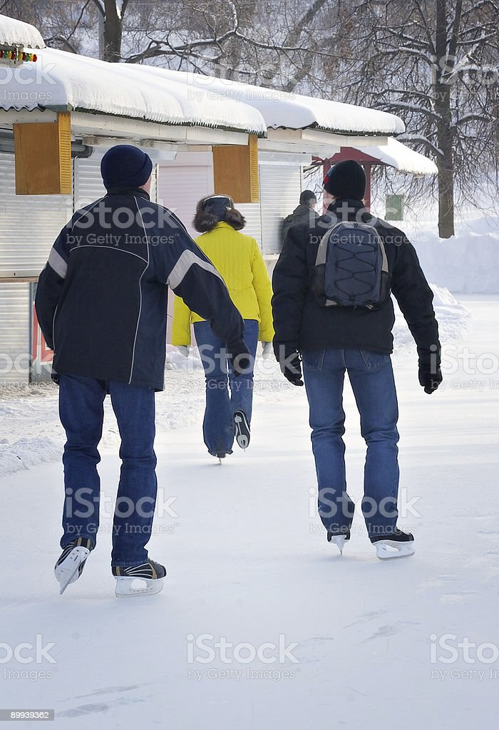 Young men on a skating rink royalty-free stock photo