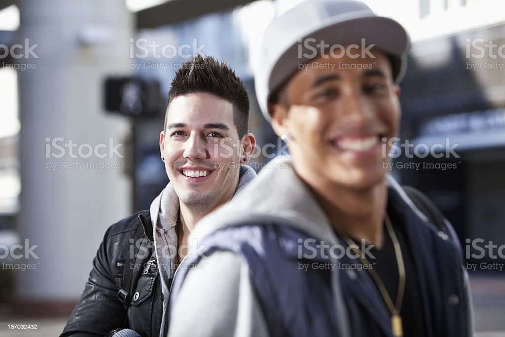Young men on city street royalty-free stock photo