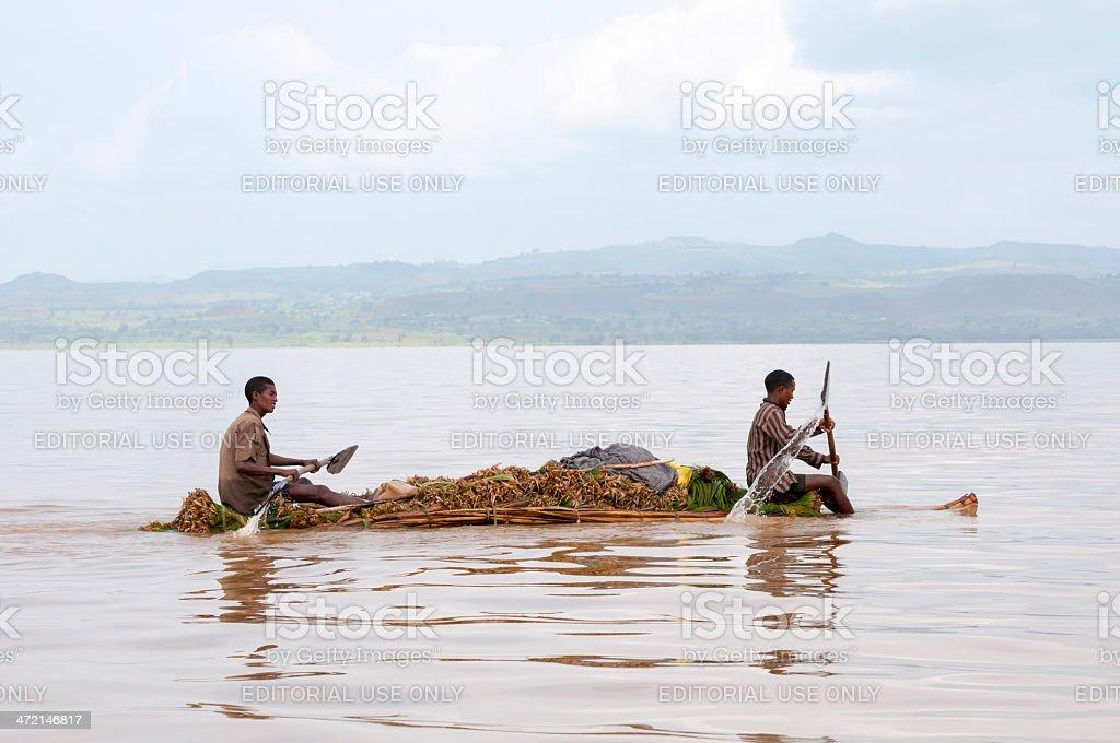 Young men paddling reed boat on Lake Tana stock photo