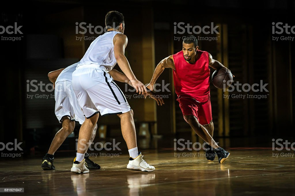 Young Men Playing Basketball stock photo