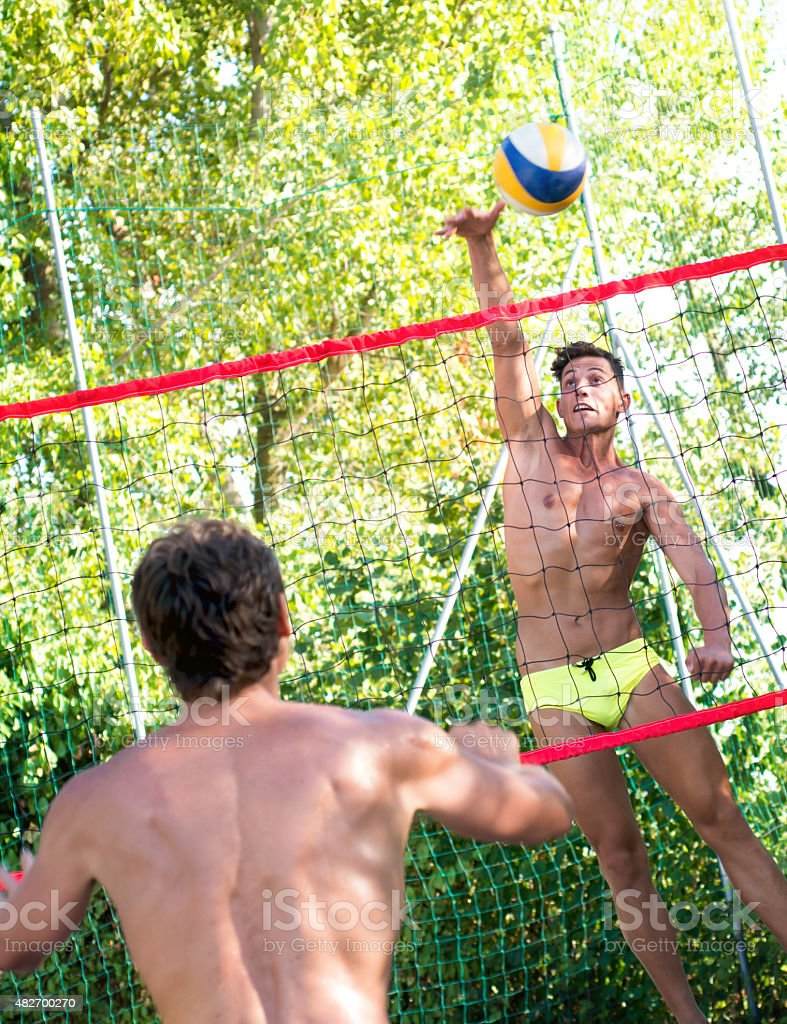 Young Men Playing Beach Volley stock photo