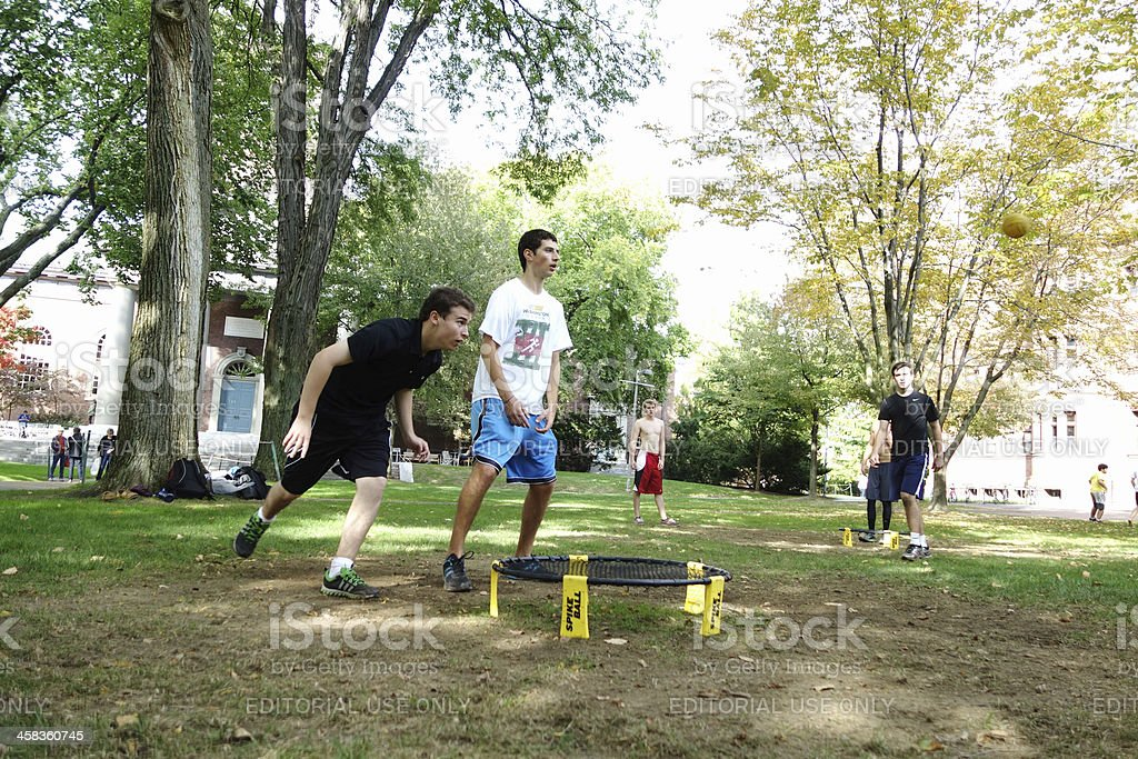 Young men playing spike ball at Harvard Yard stock photo