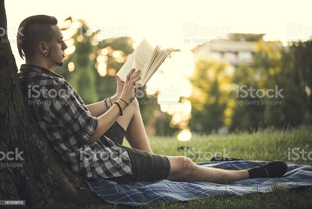 Young Men Reading Book at the Park royalty-free stock photo