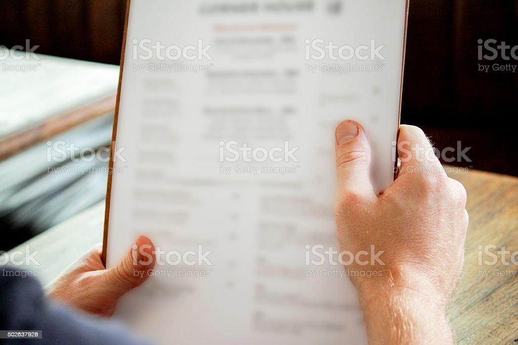 Young men selecting food and drinks stock photo