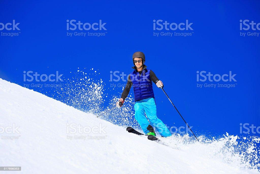 Young men snow skier skiing on sunny ski resorts stock photo