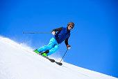 Young men snow skier skiing on sunny ski resorts