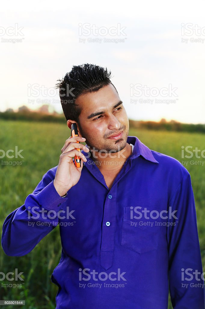 Young men talking on Smartphone stock photo
