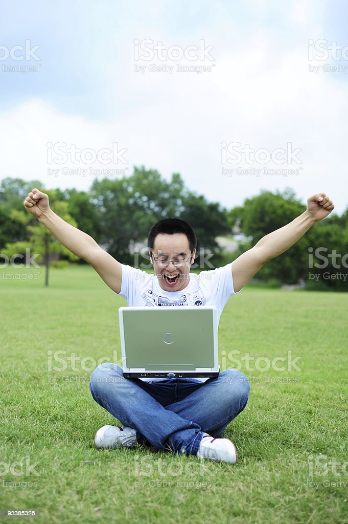 Young men using laptop in campus royalty-free stock photo