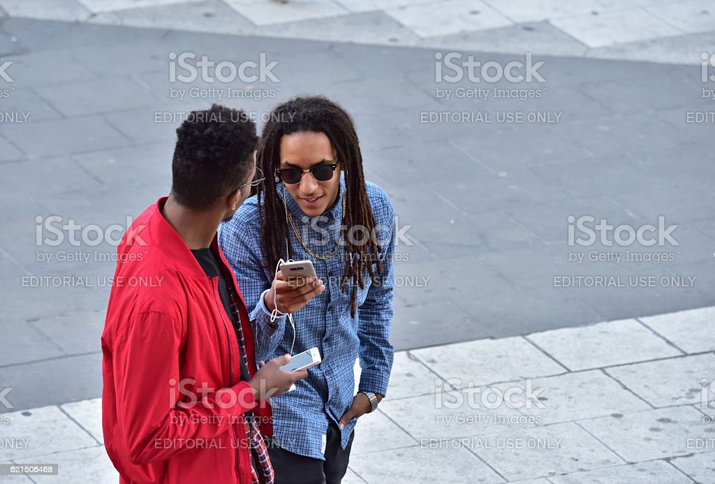 Young men using mobile smart phones stock photo