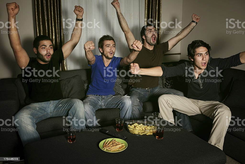 young men watching sports competition royalty-free stock photo