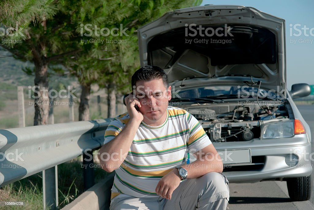 Young men with her broken car calling stock photo