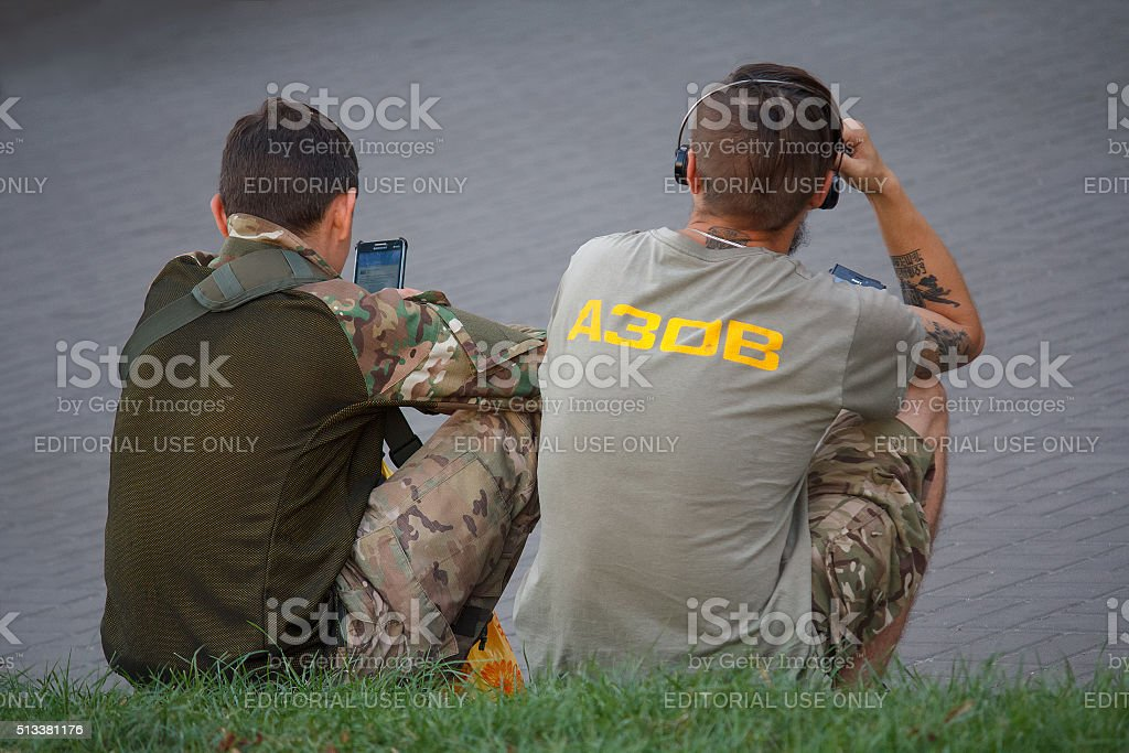 Young men with symbols of the nationalist movement 'Azov'. Kiev stock photo