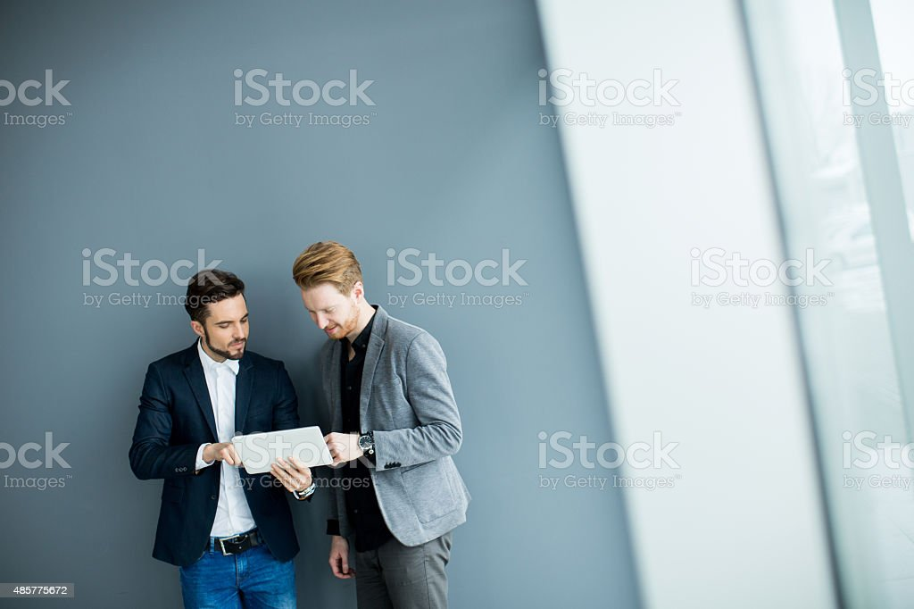 Young men with tablet stock photo