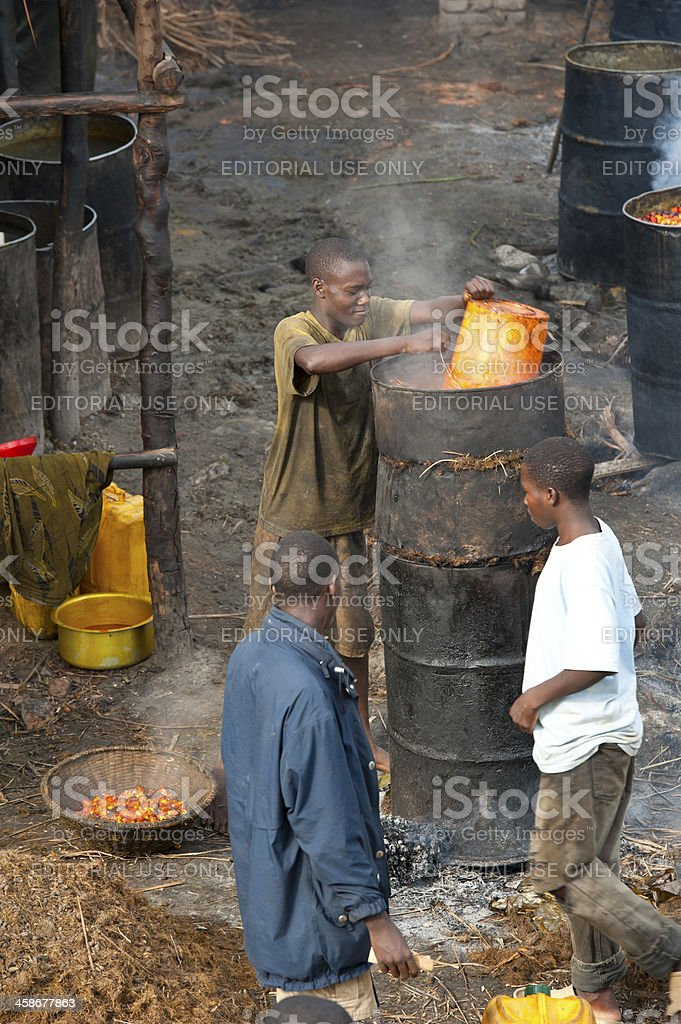 Young men working in a palm oil production, Burundi stock photo