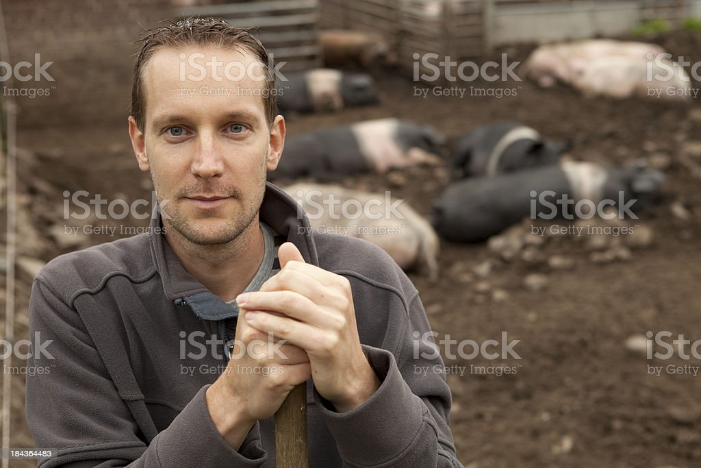 Young men working on a farm, selective focus. stock photo