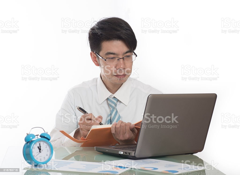 Young men working overtime in the office stock photo