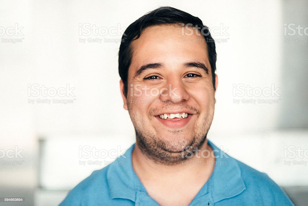 Young Mexican man with intellectual disability stock photo