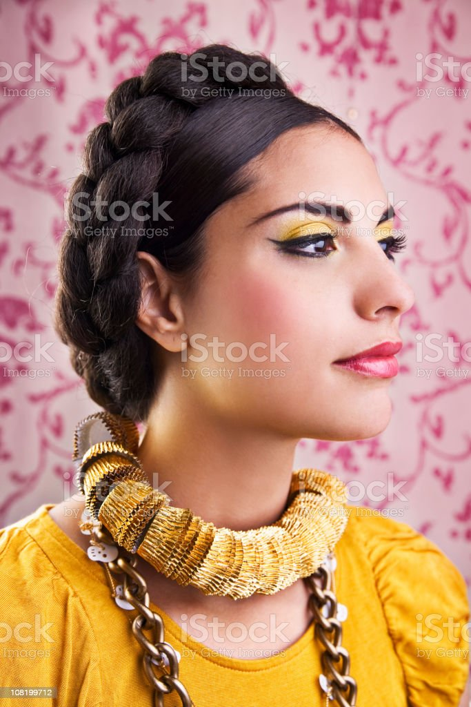 Young Mexican Woman Posing on Pink Background royalty-free stock photo