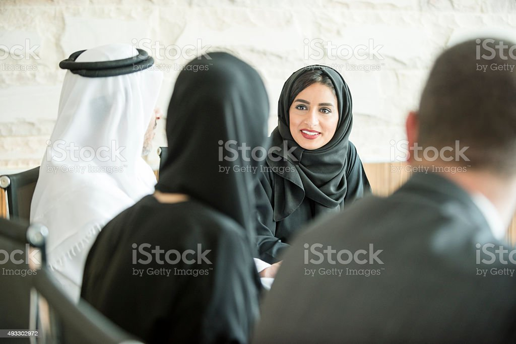 Young Middle Eastern businesswoman in business meeting stock photo