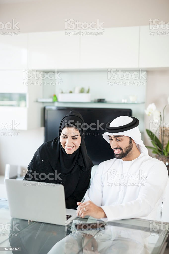Young Middle Eastern Couple in Modern Smart Home stock photo