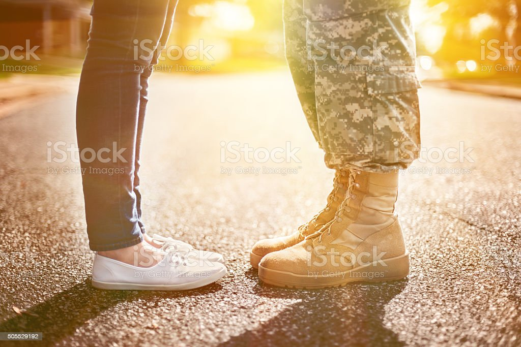 Young military couple kissing each other, homecoming concept, so stock photo