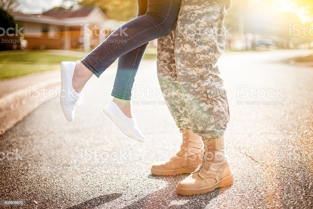 Young military couple kissing each other, homecoming concept, wa stock photo