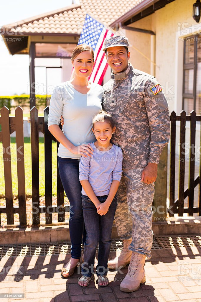young military family standing together stock photo