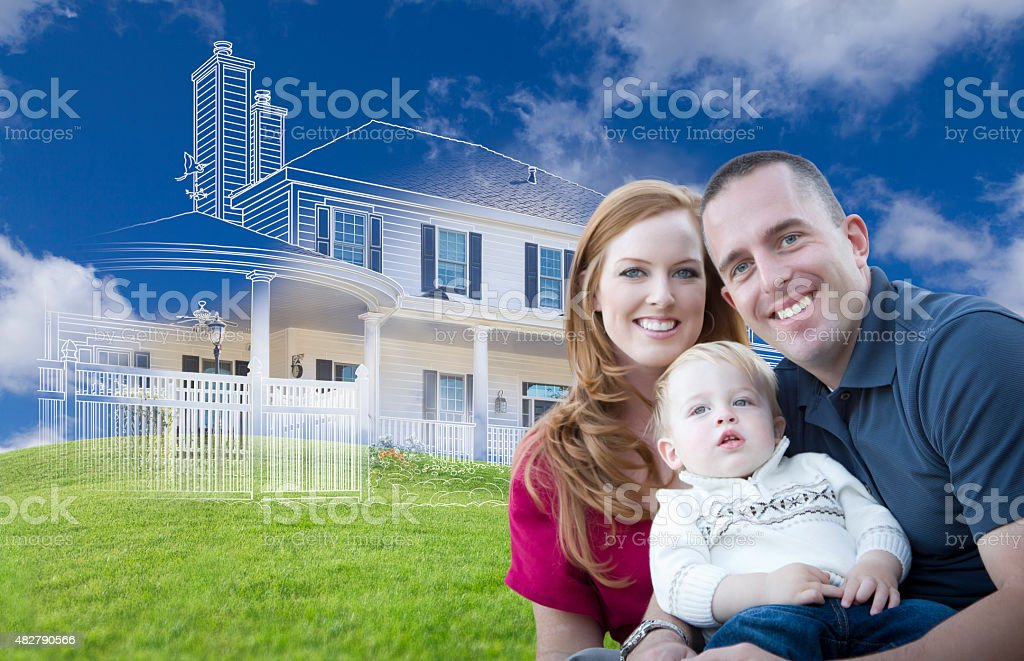 Young Military Family with Ghosted House Drawing Behind stock photo