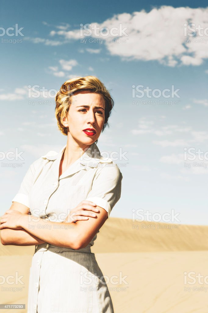 Young Military Nurse in the Harsh Desert Sand royalty-free stock photo
