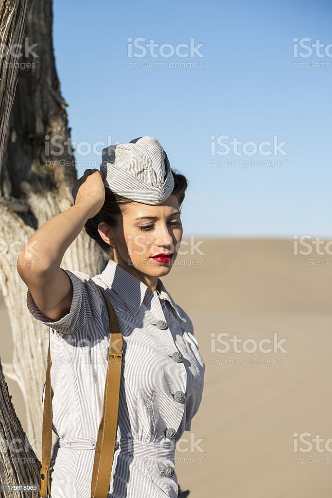 Young Military Nurse Resting Against a Tree in Desert Sun royalty-free stock photo