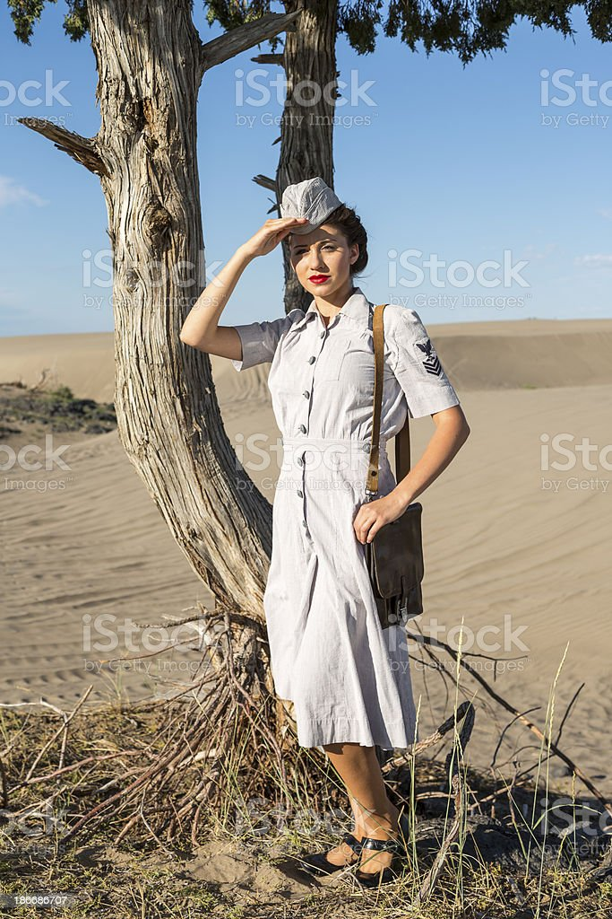 Young military nurse shades her eyes from the desert sun royalty-free stock photo