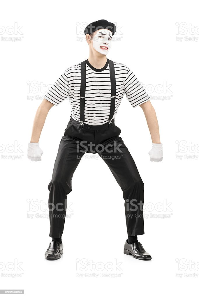 Young mime artist lifting something imaginary royalty-free stock photo
