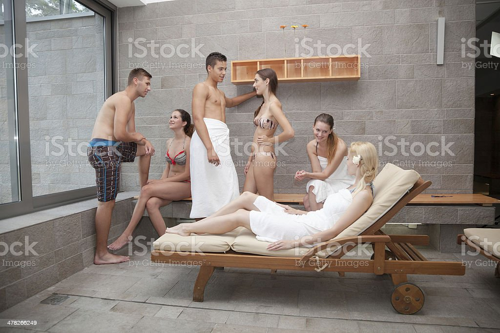young mixed group relax in heated spa room royalty-free stock photo