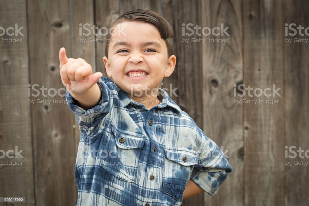 Young Mixed Race Boy Making Shaka Hand Gesture stock photo