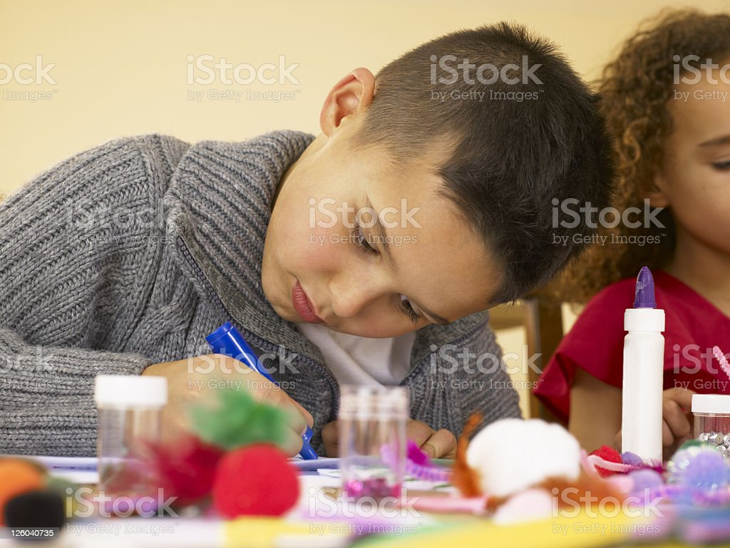 Young mixed race children doing handicrafts royalty-free stock photo